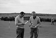 19/08/1967<br /> 08/19/1967<br /> 19 August 1967<br /> Irish Dunlop £1,000 Tournament at Tramore Golf Club, Co. Waterford. Christy O'Connor marks up his card after a round with A. Skerritt (Waterford).