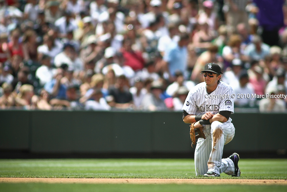 SHOT 6/10/10 2:43:05 PM - The Colorado Rockies Troy Tulowitzki pauses on the ground after not being able to handle a line drive against the Houston Astros during their game at Coors Field in downtown Denver, Co. The Rockies have struggled as a team in the 2010 season coming up short of many experts expectations. The Astros won the game 5-4.  (Photo by Marc Piscotty / © 2010)