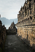 Walkway lined with bass relief engravings, Borobudur, Kedu Valley, South Central Java, Java, Indonesia, Southeast Asia