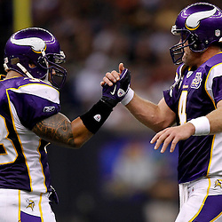 September 9, 2010; New Orleans, LA, USA;  Minnesota Vikings quarterback Brett Favre (4) celebrates with running back Naufahu Tahi (38) after throwing a touchdown pass during the NFL Kickoff season opener at the Louisiana Superdome. The New Orleans Saints defeated the Minnesota Vikings 14-9.  Mandatory Credit: Derick E. Hingle