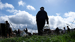 © Licensed to London News Pictures.26/08/15<br /> Egton, UK. <br /> <br /> A farmer stands watching as judging takes place at the 126th Egton Show in North Yorkshire. <br /> <br /> Egton is one of the largest village shows in the country and is run by a band of voluntary helpers. <br /> <br /> This year the event featured wrought iron and farrier displays, a farmers market, plus horse, cattle, sheep, goat, ferret, fur and feather classes. There was also bee keeping, produce and handicrafts on display.<br /> <br /> Photo credit : Ian Forsyth/LNP