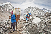 Two Nepalese Porters on their way to Mount Everest Base Camp in the Khumbu Valley, Nepal