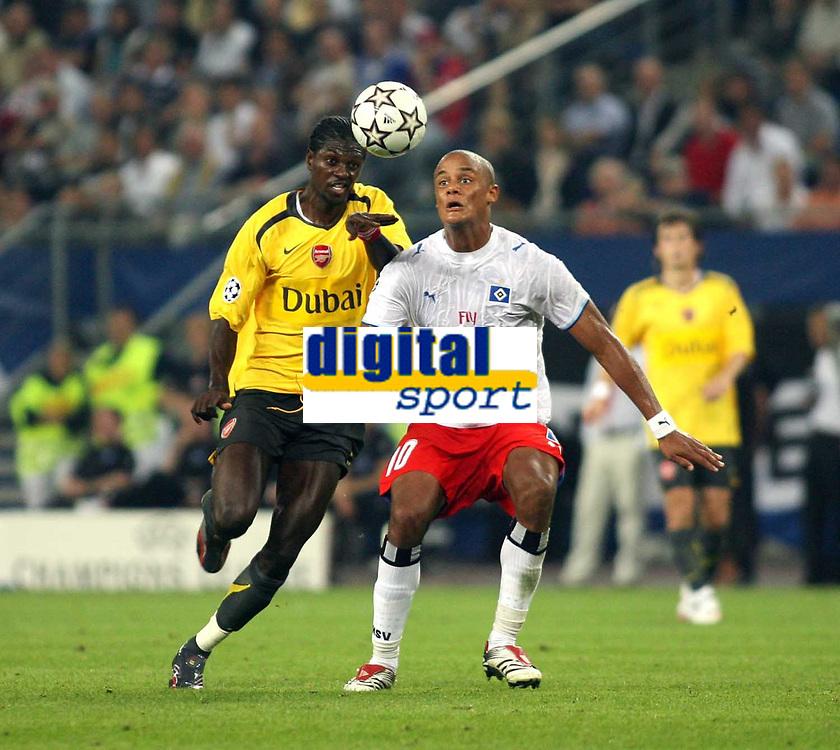 Photo: Chris Ratcliffe.<br /> Hamburg v Arsenal. UEFA Champions League, Group G. 13/09/2006.<br /> Emmanuel Adebayor of Arsenal clashes with Vincent Kompany of Hamburg.