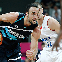 31 July 2012: Argentina Manu Ginobilo drives past Nando De Colo of France during 71-64 Team France victory over Team Argentina, during the men's basketball preliminary, at the Basketball Arena, in London, Great Britain.
