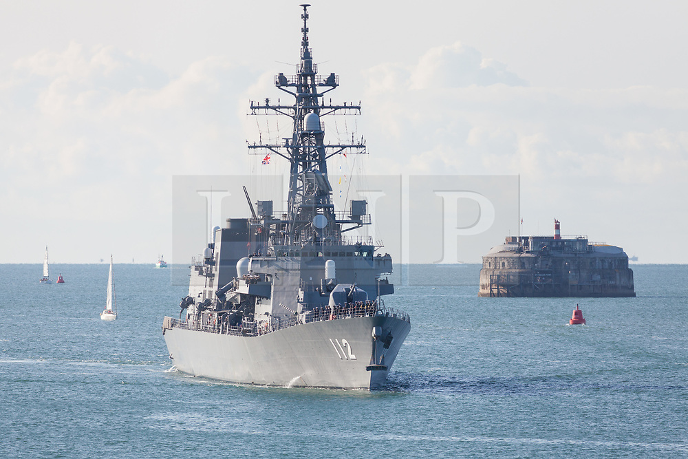 © Licensed to London News Pictures. 25/08/2018. Portsmouth, UK.  The 151-metre long destroyer JS Makinami (112) from the Japanese Maritime Self Defense Force (JMSDF) arriving in Portsmouth this morning, 25th August 2018.  This vessel and the 143-metre long cadet training vessel JS Kashima (3508) have recently conducted a passing exercise (PASSEX) with Standing NATO Maritime Group One (SNMG1) in the Baltic Sea. The ships will moor alongside in Portsmouth Naval Base and be opened to visitors over the bank holiday weekend until 28th August 2018. Photo credit: Rob Arnold/LNP