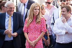 London, UK. 24 July, 2019. Carrie Symonds (c), Boris Johnson's girlfriend, waits for him to arrive in Downing Street as Prime Minister for the first time, having been formally appointed by the Queen shortly before at Buckingham Palace.