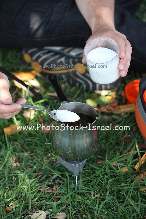 Cooking (Turkish or Greek) coffee outdoors