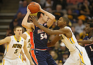 December 29 2010: Illinois Fighting Illini center Mike Tisdale (54) tries to keep the ball away from Iowa Hawkeyes forward Melsahn Basabe (1) during the first half of an NCAA college basketball game at Carver-Hawkeye Arena in Iowa City, Iowa on December 29, 2010. Illinois defeated Iowa 87-77.
