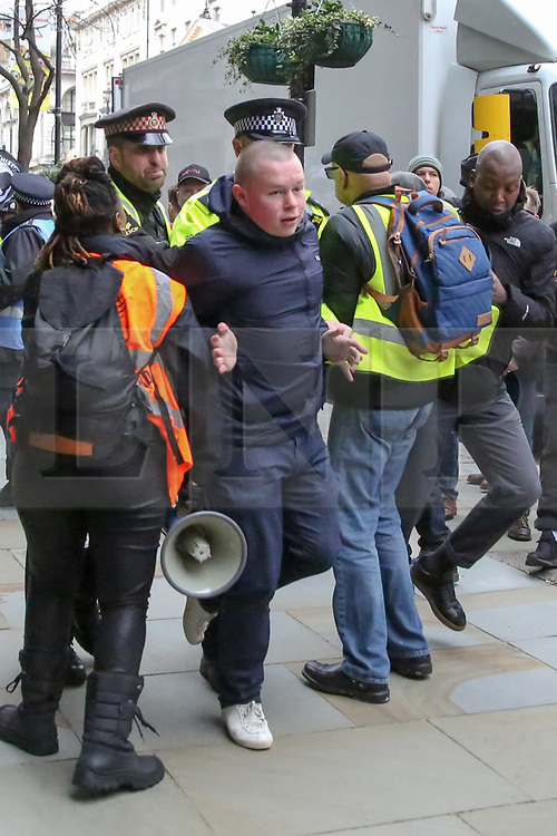© Licensed to London News Pictures. 16/03/2019. London, UK. Police arrest an man during the march. Thousands of people march against racism to mark UN World Against Racism global day of action. The horrific Islamophobic terrorist attack on a mosque in Christchurch, New Zealand on Friday 15 March 2019, that has left 49 dead is a reminder that the global anti-racist movement must take urgent action. Photo credit: Dinendra Haria/LNP