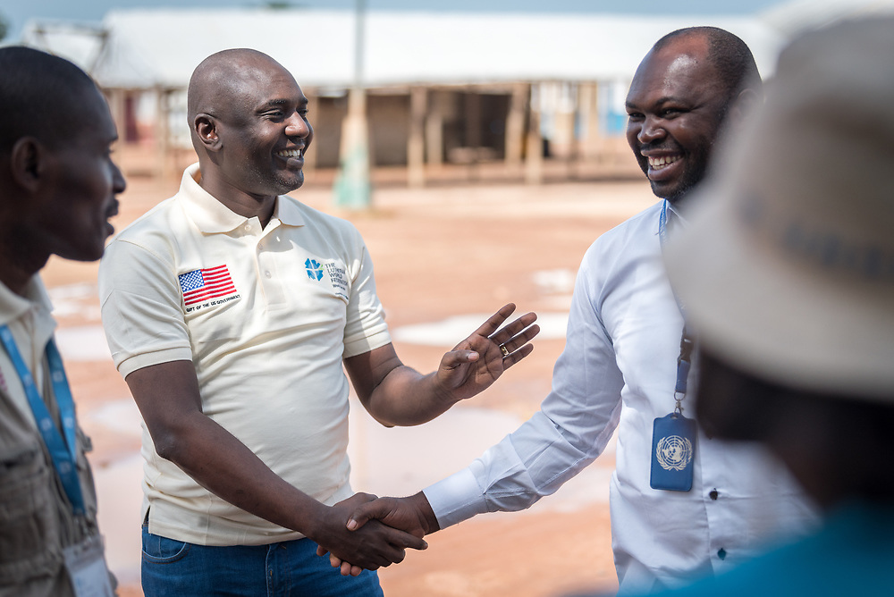5 June 2019, Gado, Cameroon: Lutheran World Federation country representative for Cameroon Philbert Habonimana (left) greets colleagues at the Gado refugee camp. Supported by the Lutheran World Federation, the Gado refugee camp in he East region of Cameroon hosts more than 25,000 refugees from neighbouring Central African Republic.