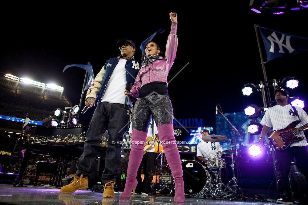 Recording artists Jay-Z and Alicia Keys perform prior to Game 2 of the 2009 World Series between the New York Yankees and The Philadelphia Phillies in Bronx, NY. (Photo by Robert Caplin)