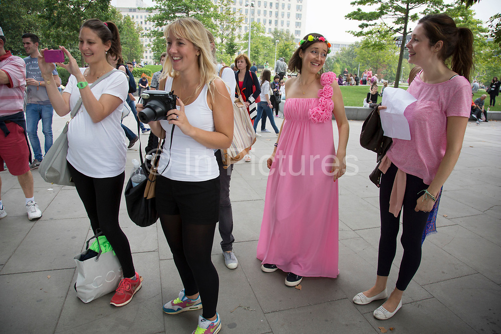 Bride to be Polly having fun with friends on the Southbank for her hen party. The group have a list of activities they have to tick off a list. The The South Bank is a significant arts and entertainment district, and home to an endless list of activities for Londoners, visitors and tourists alike.