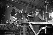 15/06/1963.06/15/1963.15 June 1963.Finnish visitors tour Bord na Mona works..the 48 members of the Finnish Peat Society, who arrived in dublin on Friday 14/06/1963, toured Bord na Mona works in Offaly and Kildare on Saturday..Mr. V. Puustjarvi, University of Helsinki  and Mr. P. McEvilly (glasses), Manager Croghan Briquette Factory,  and other members of the party watching the working of a briquette baling at Croghan briquette factory near Mount Lucas, Co. Offaly. .