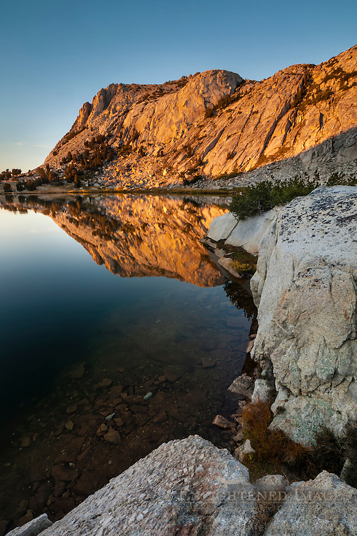Alpenglow at sunset on Fletcher Peak reflected in Vogelsang Lake, Yosemite National Park, California