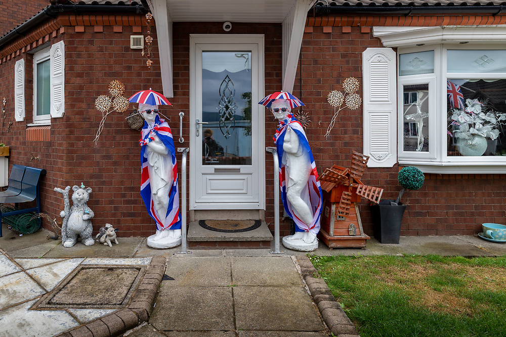 House decorated ready for the loyalist Orange March. Shankill, Belfast, NI, 2021