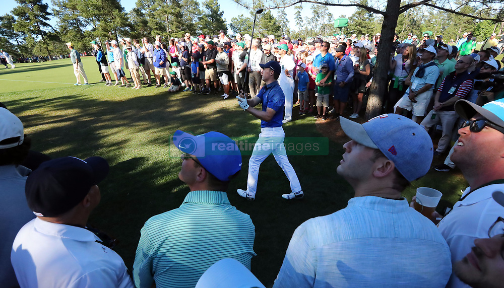 Jordan Spieth hits from deep in the gallery on the 15th fairway during the third round of the Masters Tournament at Augusta National Golf Club in Augusta, Ga., on Saturday, April 8, 2017. (Photo by Curtis Compton/Atlanta Journal-Constitution/TNS) *** Please Use Credit from Credit Field ***