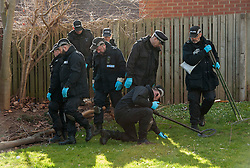 © Licensed to London News Pictures.  03/03/2015, Bristol, UK.  Police forensics officers search by houses after private ambulance leaves Barton Court, Barton Hill during the search for missing teenager Rebecca Watts aged 16 who left home a mile away in Crown Hill in the St George area of Bristol last Thursday. Police have carried out extensive searches across Bristol and today said they had found body parts in Barton Court. Up to 7 people have now been arrested in connection with the case with 2 arrested on suspicion of the murder of Becky Watts, having previously been arrested on suspicion of kidnapping her.  Photo credit : Simon Chapman/LNP