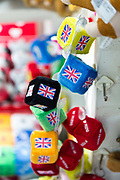 Fuzzy dice with the Union Jack hang on display at a small shop at the China Commodity City in Yiwu, Zhejiang Province, China on 06 March  2013. The city of Yiwu is known as one of China's largest trading centers for small merchandise and light industry, drawing buyers from around the world. Uncertain global demand, a stronger yuan currency and rising labour costs have taken their toll on Chinese exporters, but analysts believe sales could pick up modestly in 2014 due to improved demand from the United States and Europe.