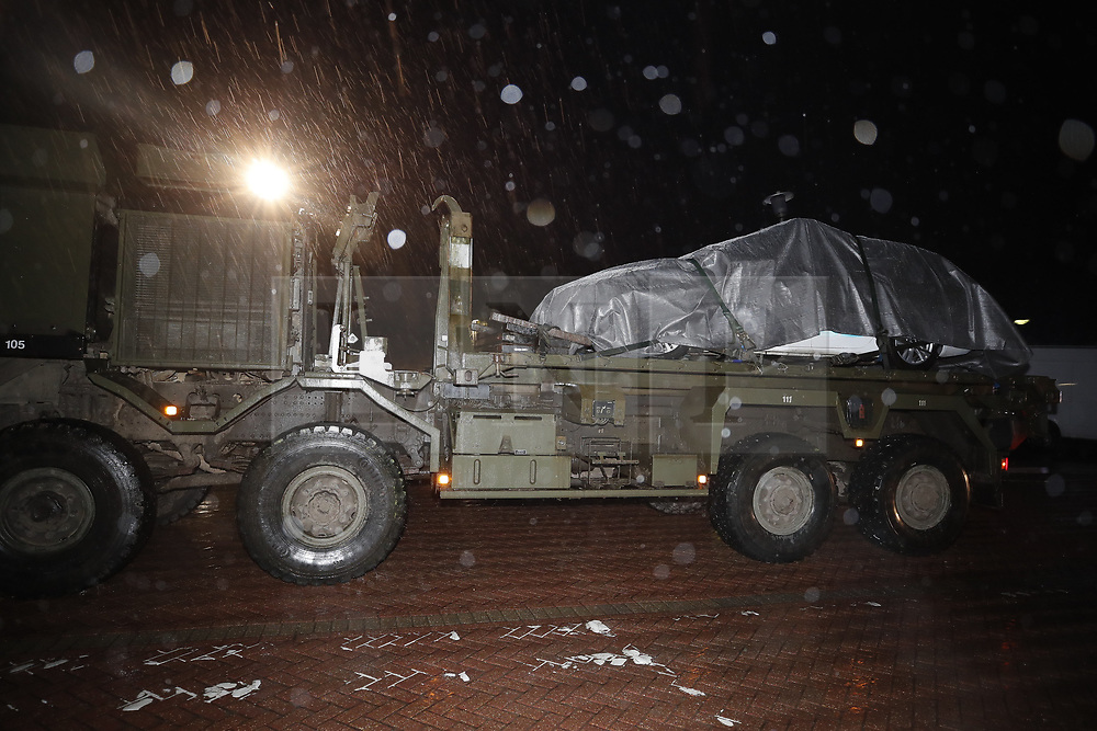 © Licensed to London News Pictures. 09/03/2018. Salisbury, UK. A military low loader transports police car from the Accident and Emergency entrance of Salisbury District hospital. Former Russian spy Sergei Skripal and his daughter Yulia are critically ill after being poisoned with nerve agent. The couple where found unconscious on bench in Salisbury shopping centre. A policeman who went to their aid is recovering in hospital. Photo credit: Peter Macdiarmid/LNP