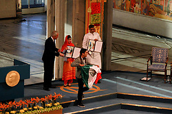A man (front) holding the Mexican flag disturbs the Nobel Peace Prize awarding ceremony in Oslo, Norway, Dec. 10, 2014. Kailash Satyarthi and Malala Yousafzai, two child welfare activists from Indian and Pakistan respectively, on Wednesday received the 2014 Nobel peace prize. EXPA Pictures © 2014, PhotoCredit: EXPA/ Photoshot/ Liu Min<br /> <br /> *****ATTENTION - for AUT, SLO, CRO, SRB, BIH, MAZ only*****