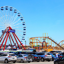 Ocean City, MD, USA - May 26, 2018: The large Ferris Wheel is a popular amusement ride on the boardwalk.