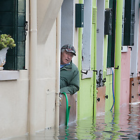 A man keep an eye on the rising water in Burano More than 59% of Venice was under water on Thursday, as the historic lagoon town was hit by exceptionally high tides. The sea level rose above 140cm overnight and was expected to remain above critical levels for about 15 hours.
