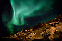 The Aurora Borealis (Northern Lights) at Ersfjordbotn in Tromso, Norway with a human face shape.
