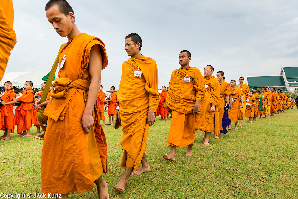 "23 APRIL 2013 - BANGKOK, THAILAND:   Buddhist monks and novices file into the opening ceremony to mark Bangkok as the World Book Capital City 2013. UNESCO awarded Bangkok the title. Bangkok is the 13th city to assume the title of ""World Book Capital"", taking over from Yerevan, Armenia. Bangkok Governor Suhumbhand Paribatra announced plans that the Bangkok Metropolitan Administration (BMA) intends to encourage reading among Thais. The BMA runs 37 public libraries in the city and has modernised 14 of them. It plans to build 10 more public libraries every year. Port Harcourt, Nigeria will be the next World Book Capital in 2014..PHOTO BY JACK KURTZ"