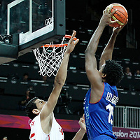 04 August 2012: France Mickael Gelabale dunks on Tunisia Salah Mejri during 73-69 Team France victory over Team Tunisia, during the men's basketball preliminary, at the Basketball Arena, in London, Great Britain.