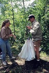 Jodi & Shay Weighing Black Bear