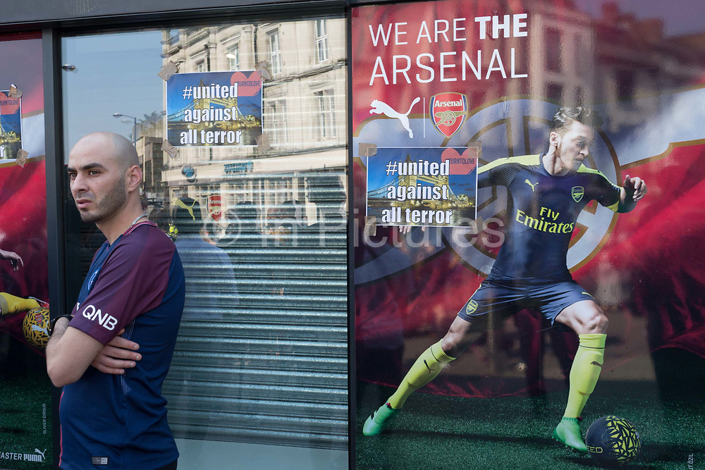 Following the attack on a group of Muslim men outside the Finsbury Park mosque which killed one person and seriously injured another ten, defiant messages are stuck to the Arsenal football shop window, on 19th June 2017, in the borough of Islington, north London, England.