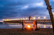 People Having A Bonfire On The Beach At The Pier In Oceanside