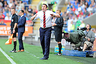 Cardiff city manager Malky Mackay shouts instructions to his team.   Barclays Premier league, Cardiff city v Everton at the Cardiff city Stadium in Cardiff,  South Wales on Saturday 31st August 2013. pic by Andrew Orchard,  Andrew Orchard sports photography,