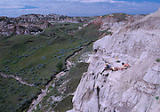 Paleontologist Phil Currie's excavates at Dinosaur Provincial Park, a protected reserve of one of the most abundant resources of Cretaceous dinosaurs in the world.  This site contains Centrosaurs.