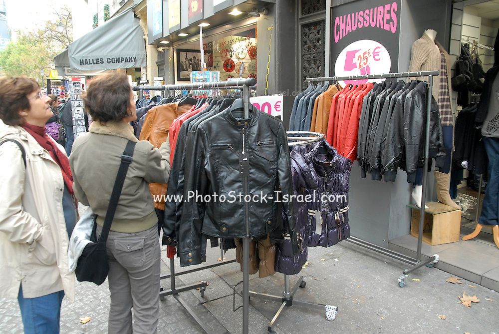 France, Paris, clothes and coats for sale at an outdoor, street market