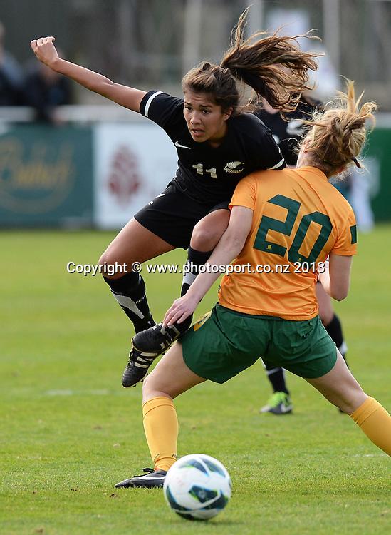 Chloe Knott collides with Australia's Alisha Bass. New Zealand Junior Football Ferns v Australia Young Matildas. Women's U20 International. Kiwitea St, Auckland. Saturday 27 July 2013. Photo: Andrew Cornaga/www. Photosport.co.nz