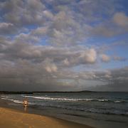 A man walks along Noosa Beach in Noosa Heads, Australia, on the Sunshine Coast.