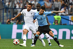 France's Corentin Tolisso and Uruguay's Nahitan Nandez during the FIFA World Cup 2018 Round of 8 France v Uruguay match at the Nizhny Novgorod Stadium Russia, on July 6, 2018. France won 2-0. Photo by Christian Liewig/ABACAPRESS.COM