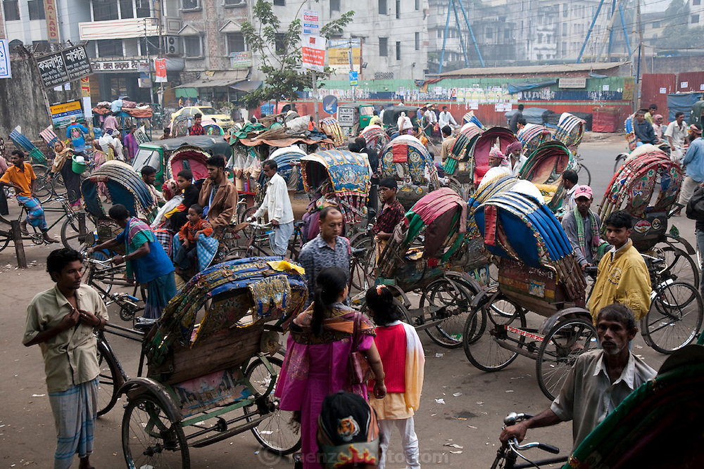Rickshaw drivers tout for customers outside the main train station in Dhaka, Bangladesh.