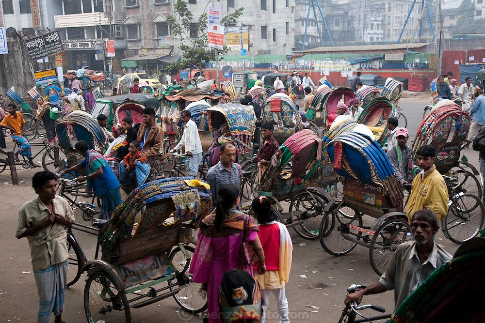 Rickshaw drivers tout for customers outside the main train station in Dhaka, Bangladesh.