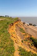 Soft cliffs rapid coastal erosion on North Sea coastline, coast at Bawdsey, Suffolk, England, Uk 1940s pill box