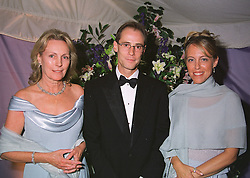 Left to right, the DOWAGER VISCOUNTESS PORTMAN and VISCOUNT & VISCOUNTESS PORTMAN at a ball in London on 30th June 1999. MTZ 14