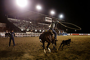 Arianna Assini of Tucson, Arizona competes in breakaway roping during the Cody Nite Rodeo Finals at Stampede Park in Cody, Wyoming on Thursday, Aug. 30, 2018.