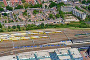 Nederland, Gelderland, Nijmegen, 29-05-2019; binnenstad Nijmegen, NS Station Nijmegen met emplacement. Op het stationsplein en busstation.<br /> Nijmegen city center, railway station with yard. On the station square the bus station.<br /> <br /> luchtfoto (toeslag op standard tarieven);<br /> aerial photo (additional fee required);<br /> copyright foto/photo Siebe Swart