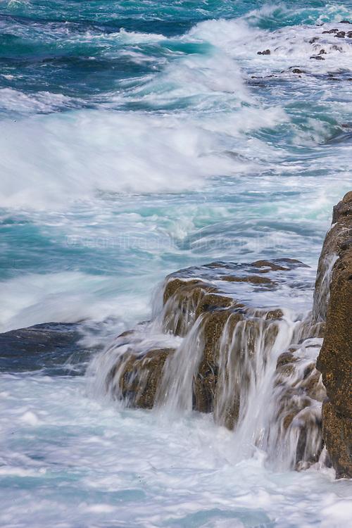 Waves crashing on Atlantic coast and The Burren, County Clare, Ireland