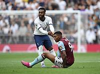 Football - 2019 / 2020 Premier League - Tottenham Hotspur vs. Aston Villa<br /> <br /> Tottenham Hotspur's Danny Rose helps up Aston Villa's Wesley, at The Tottenham Hotspur Stadium.<br /> <br /> COLORSPORT/ASHLEY WESTERN