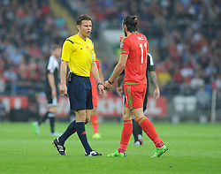Gareth Bale of Wales (Real Madrid) talks with Referee Felix Brych - Photo mandatory by-line: Alex James/JMP - Mobile: 07966 386802 - 12/06/2015 - SPORT - Football - Cardiff - Cardiff City Stadium - Wales v Belgium - Euro 2016 qualifier