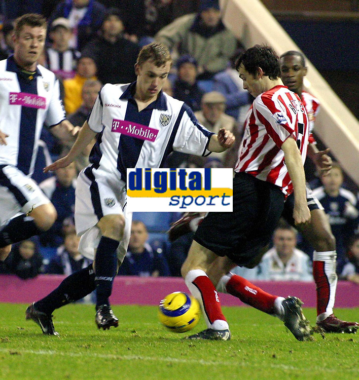 Photo: Dave Linney.<br />West Bromwich Albion v Sunderland. The Barclays Premiership. 21/01/2006.West Brom's Stuart Nicholson(C) tries to find a way through the Sunderland defence.