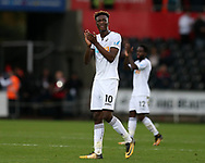 Tammy Abraham of Swansea city applauds the Swansea fans at the end of the game. Premier league match, Swansea city v Huddersfield Town at the Liberty Stadium in Swansea, South Wales on Saturday 14th October 2017.<br /> pic by  Andrew Orchard, Andrew Orchard sports photography.