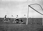 13/10/1963<br /> 10/13/1963<br /> Ireland v Austria, European Championship match at Dalymount Park, Dublin. Ireland won the game 3-2. Austrian keeper Gernot Fraydl dives  to the ground having punched the shot away, Ireland's Ambrose fog arty (10) on the ground while Austria's Erich Hasenkopf (4) stands ready in support.